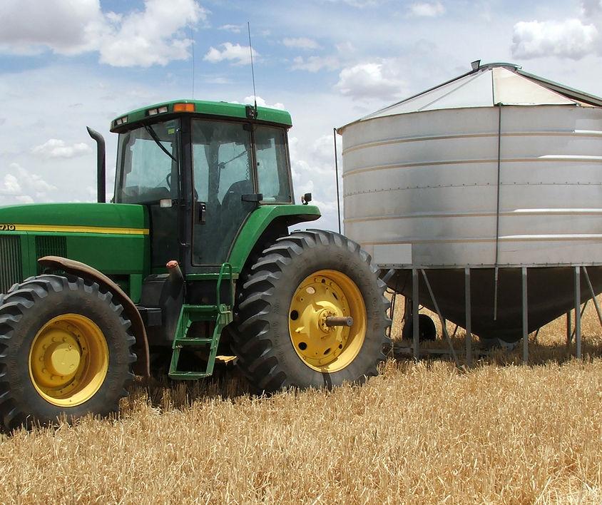 bigstockphoto_Farm_-_Tractor_And_Silo_145674
